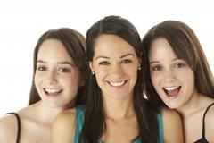 studio portrait of three young women - stock photo