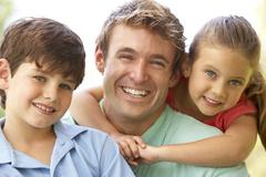 father with children in park - stock photo