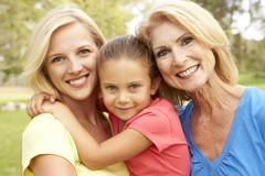 Grandmother with mother and daughter in park Stock Photos
