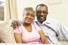 senior couple relaxing at home together - stock photo