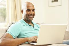 man using laptop at home - stock photo