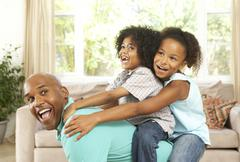 Father playing with children at home Stock Photos