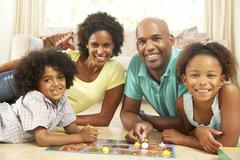 family playing board game at home - stock photo