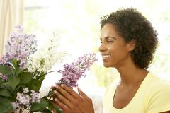 Woman flower arranging at home Stock Photos