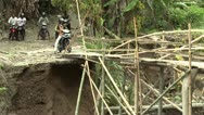 Stock Video Footage of Motorbike Crosses Dangerous Unstable Bridge
