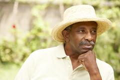 senior man with thoughtful expression - stock photo