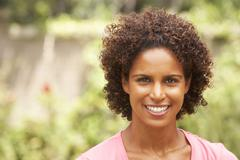 Portrait of smiling young woman Stock Photos