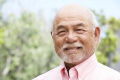 portrait of smiling senior man - stock photo