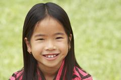portait of smiling young girl outdoors - stock photo