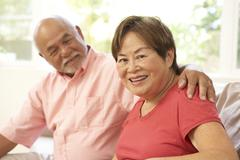 Senior couple relaxing at home together Stock Photos
