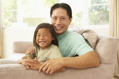 father and daughter relaxing at home - stock photo