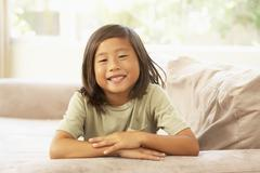 young boy relaxing on sofa at home - stock photo