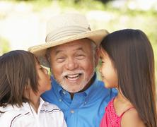 Grandfather with grandchildren in garden Stock Photos