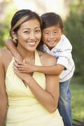 Mother and son hugging in garden Stock Photos
