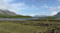 Connemara national park, Lough Inagh + pan bog, heathland, mountain range Stock Footage