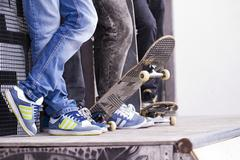 Skate boarders on a pipe Stock Photos