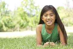 portrait of young girl in park - stock photo
