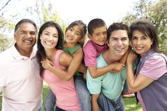 extended family group in park - stock photo