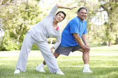Senior couple exercising in park Stock Photos