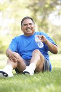 senior man relaxing after exercise - stock photo