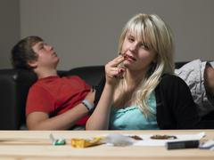 Teenage couple taking drugs at home Stock Photos