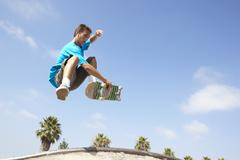 teenage boy in skateboard park - stock photo