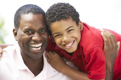 Portrait Of Father And Son In Park Stock Photos