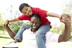 Portrait of Happy Father and Son In Park Stock Photos