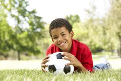 Boy In Park With Football Stock Photos