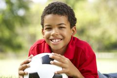 Boy In Park With Football Stock Photos