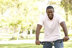 Man Riding Bike In Park - stock photo