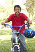 Boy Riding Bike In Park - stock photo