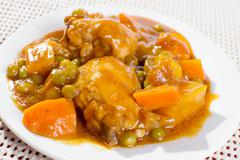 Chicken afritada on plate Stock Photos