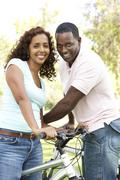Couple On Cycle Ride in Park Stock Photos