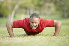 Senior Man Exercising In Park Stock Photos