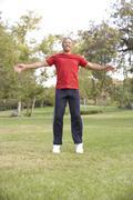 Senior Man Exercising In Park - stock photo