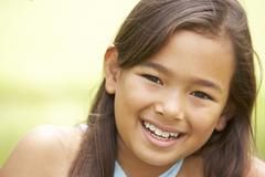 Portrait Of Young Girl In Park Stock Photos