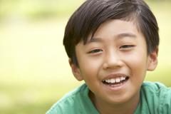Portrait Of Young Boy In Park - stock photo