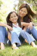 Mother And Daughter Enjoying Day In Park Stock Photos