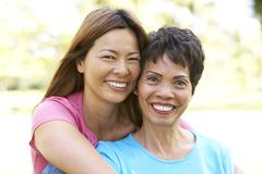 Stock Photo of Senior Woman With Adult Daughter In Park