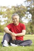 Stock Photo of Senior Man Relaxing After Exercise