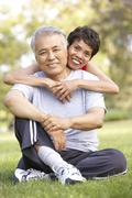 Senior Couple Resting After Exercise Stock Photos