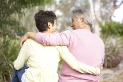 Back View Of Senior Couple In Park - stock photo