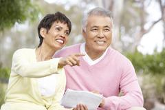 Portrait Of Senior Couple Looking At Map - stock photo