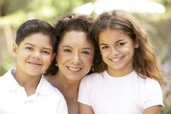 Grandmother With Grandchildren In Garden - stock photo
