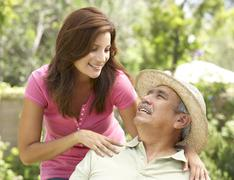 Senior Man With Adult Daughter In Garden Stock Photos