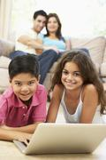 Children Using Laptop At Home Stock Photos