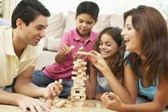Family Playing Game Together At Home Stock Photos