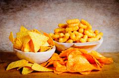 Chips, nachos and curls Stock Photos