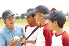 Young Boys In Baseball Team With Coach Stock Photos